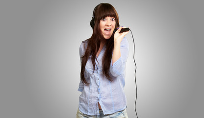 Girl With Headset Singing On Mike