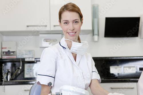 A female dentist in a dental surgery