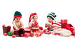 Four babies in xmas costumes playing with gifts