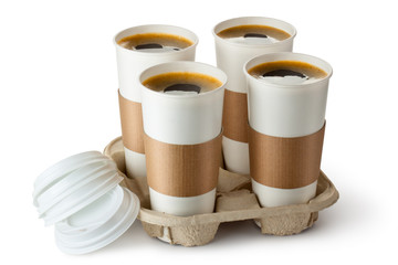 Four opened take-out coffee in holder