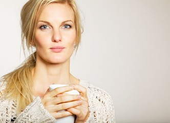 Woman with Unkept Hair Holding a Cup of Coffee
