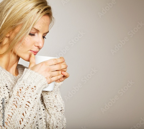 Beautiful Woman Enjoying the Coffee's Aroma