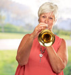 Mature Woman Blowing Her Trumpet