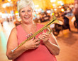Senior Woman Blowing Her Trumpet