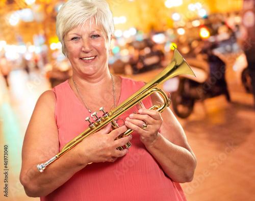 Senior Woman Blowing Her Trumpet