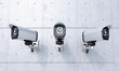 Leinwandbild Motiv Three Security cameras frontal view