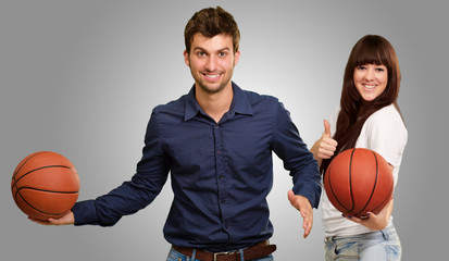 Young Couple Playing Basketball