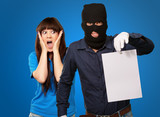 Burglar Man Holding Paper In Front Scared Woman