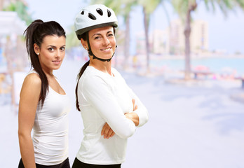 Portrait Of Two Happy Cyclist Woman
