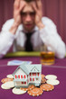 Man risking his house at poker game