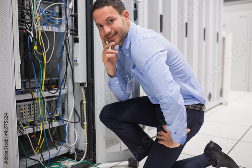 Smiling man checking the servers