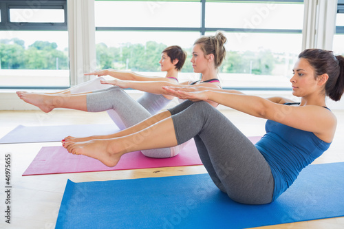 Women in boat pose in yoga class