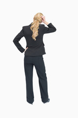 Thinking businesswoman backwards
