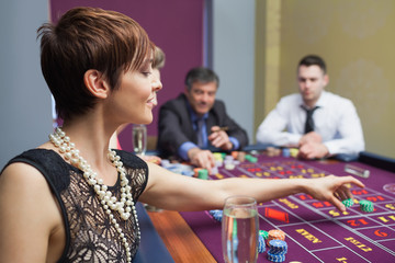 Woman placing a bet