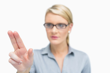 Businesswoman using two fingers to point