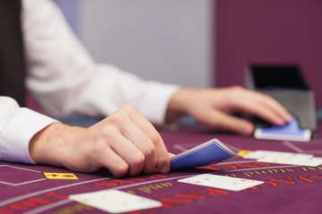 Dealer distributing cards in a casino