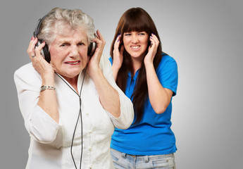 Mother And Daughter Wearing Headphone