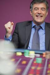 Winning man playing roulette