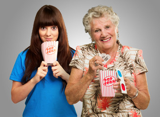 Mother And Daughter With Pop Corn, Ticket And 3d Glass