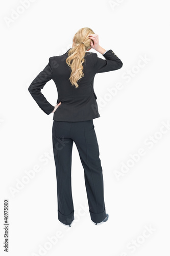 Thinking businesswoman backwards