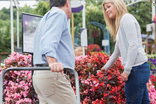 Man pushing the trolley while talking