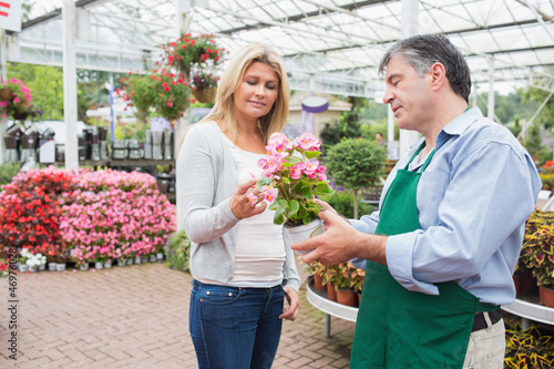 Woman talking to worker about plant