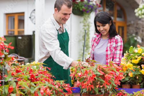 Customer being shown plants by employee