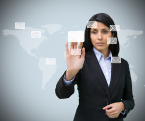 Businesswoman pushing email symbol