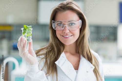 Student standing at the laboratory smiling