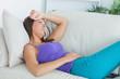 Anxious woman lying on sofa
