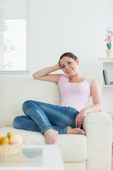 Relaxing woman sitting on a couch