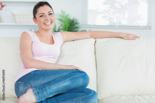 Woman relaxing while sitting on a couch
