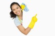 Woman in rubber gloves pointing to the white surface