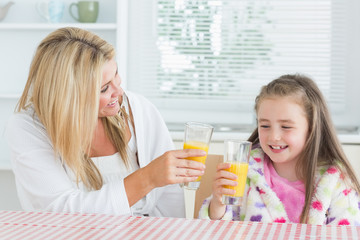 Mother and child drinking juice