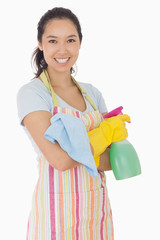 Happy woman holding cleaning products