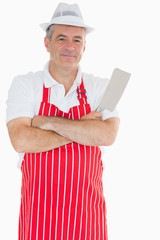 Butcher with arms crossed holding meat cleaver
