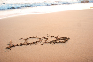 Word love on the sand