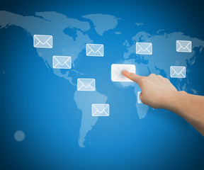 Hand selecting email from world map interface