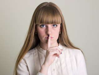 girl with his finger near the lips