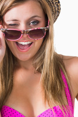 Blonde winking while holding sun glasses