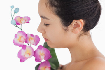 Woman smelling on orchids