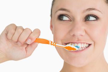 Cute woman washing her teeth