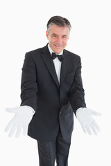 Waiter waiting with opened arms