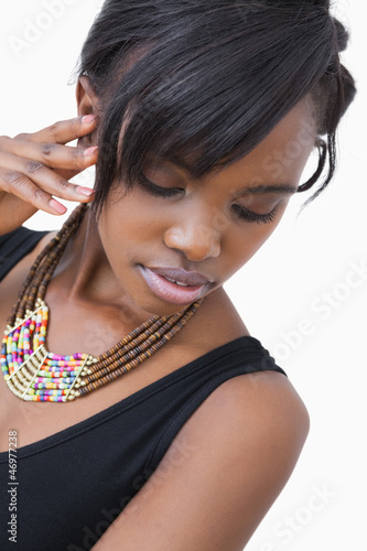 Woman posing in tribal style necklace