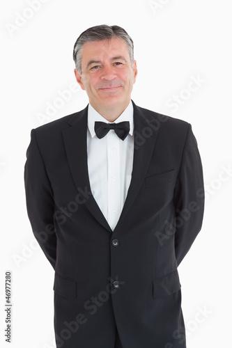 Waiter smiling at camera