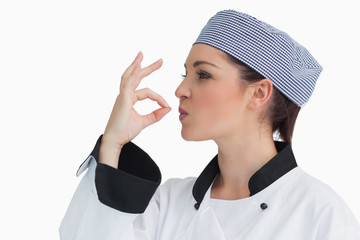 Chef making sign for tasty with her hands
