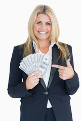 Happy Well-dressed woman holding dollars