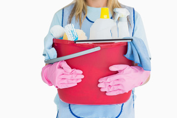 Cleaning woman holding a bucket of cleaning supplies