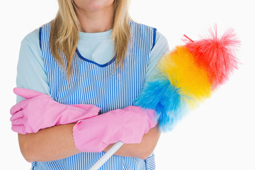 Cleaning woman holding feather duster