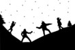 Family in a snowball fight in winter in mountain silhouette